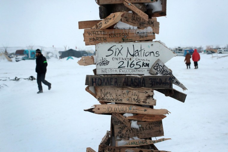 Snow covers the ground at Oceti Sakowin Camp on the edge of the Standing Rock Sioux Reservation on December 1, 2016 outside Cannon Ball, North Dakota. Native Americans and activists from around the country have been gathering at the camp for several months trying to halt the construction of the Dakota Access Pipeline. The proposed 1,172-mile-long pipeline would transport oil from the North Dakota Bakken region through South Dakota, Iowa and into Illinois. (Photo by Scott Olson/Getty Images)