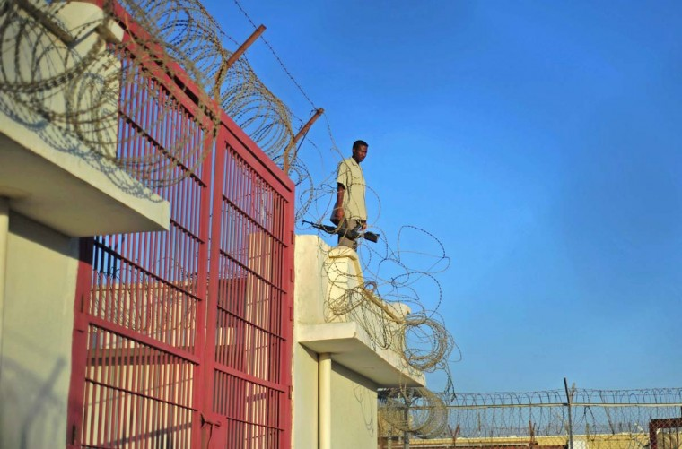 A prison warden stands at a prison in Garowe, Puntland state, in northeastern Somalia. The prison facilitates the rehabilitation of convicted Somali pirates and suspected Al-Shabaab jihadists. (MOHAMED ABDIWAHAB/AFP/Getty Images)