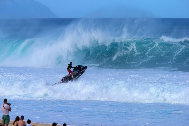 A Hawaiian lifeguard on a jet ski goes out to make a rescue on December 25, 2016 on the island of Oahu in Hawaii, following competition in Billabong Pipe Masters. Christmas Day at the pipeline was the best day of the winter season so far with huge tubes coming through great surfing rides and heavy wipeouts with the world's best surfers catching waves and dominating the pack. (Brian Bielmann/AFP/Getty Images)