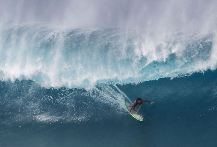 Mason Ho of Hawaii surfs on December 25, 2016 on the island of Oahu in Hawaii, following competition in Billabong Pipe Masters. Christmas Day at the pipeline was the best day of the winter season so far with huge tubes coming through great surfing rides and heavy wipeouts with the world's best surfers catching waves and dominating the pack. (Brian Bielmann/AFP/Getty Images)