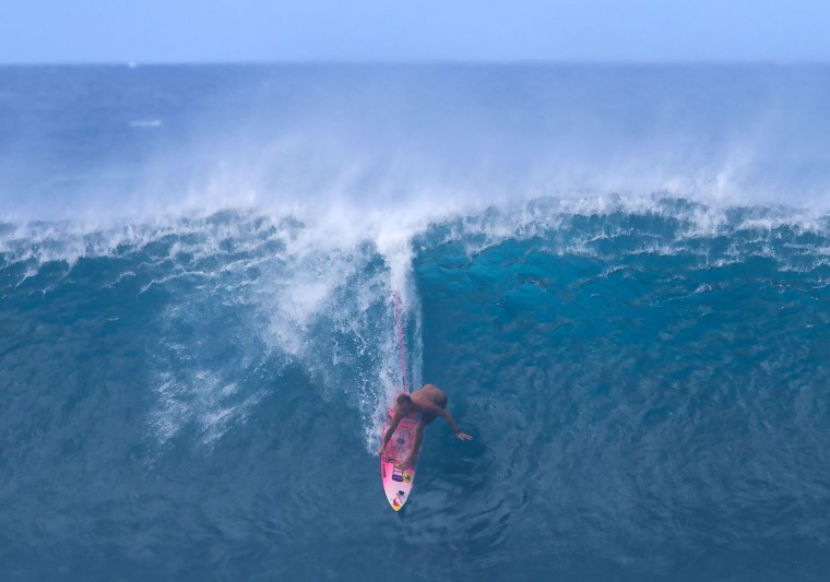 Jamie O'Brien of Hawaii balances on a steep drop on December 25, 2016 on the island of Oahu in Hawaii, following competition in Billabong Pipe Masters. Christmas Day at the pipeline was the best day of the winter season so far with huge tubes coming through great surfing rides and heavy wipeouts with the world's best surfers catching waves and dominating the pack. (Brian Bielmann/AFP/Getty Images)