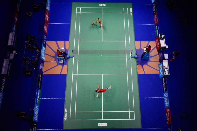Carolina Marin (top) from Spain plays against Sun Yu from China, during their women's singles badminton match at the Dubai World Superseries Finals badminton tournament at the Hamdan Sports Complex in Dubai on December 14, 2016. (Stringer/AFP/Getty Images)