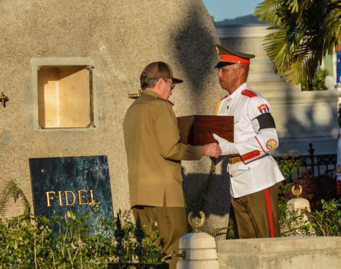 Cuban President Raul Castro places the urn with the ashes of his brother Fidel Castro in his tomb at the Santa Ifigenia cemetery in Santiago de Cuba on December 4, 2016. Fidel Castro's ashes were buried alongside national heroes in the cradle of his revolution on Sunday, as Cuba opens a new era without the communist leader who ruled the island for decades. (Marcelino Vazquez/AFP/Getty Images)