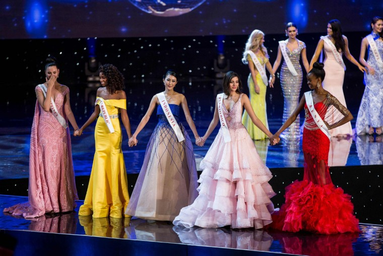 (L-R): Finalists Miss Philippines Catriona Elisa Gray; Miss Dominican Republic Yaritza Miguelina Reyes Ramirez; Miss Indonesia Natasha Mannuela; Miss Puerto Rico Stephanie Del Valle; and Miss Kenya Evelyn Njambi Thungu are pictured on stage during the Grand Final of the Miss World 2016 pageant at the MGM National Harbor December 18, 2016 in Oxon Hill, Maryland. (AFP PHOTO / ZACH GIBSON)