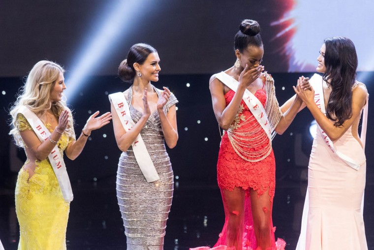 Miss Kenya Evelyn Njambi Thungu (2nd-R) reacts after being named a finalist during the Grand Final of the Miss World 2016 pageant at the MGM National Harbor December 18, 2016 in Oxon Hill, Maryland. (AFP PHOTO / ZACH GIBSON)