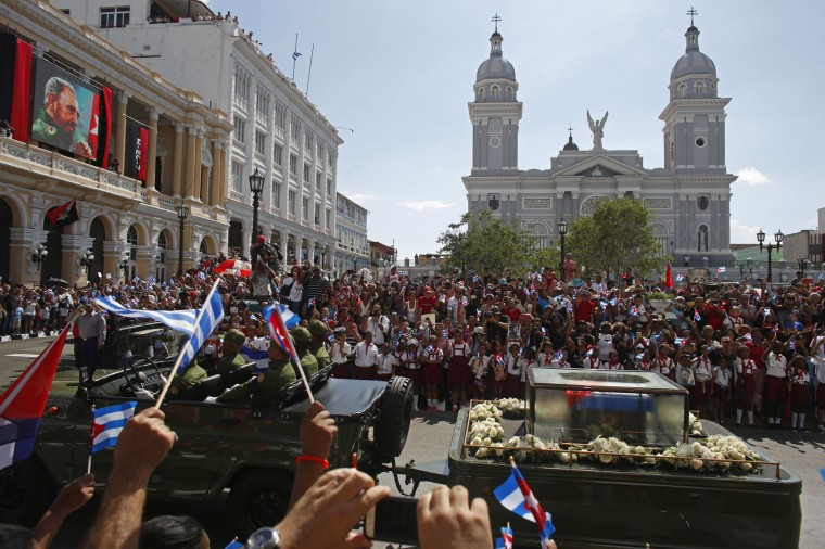 "People chant ""I am Fidel!"" as the motorcade carrying the ashes of the late Cuban leader Fidel Castro leaves Cespedes Park in Santiago, Cuba, on Dec. 3, 2016. After days of national mourning and a tour of his ashes through the countryside, his remains have arrived at the city where they will be laid to rest. (AP Photo/Dario Lopez-Mills, File)"