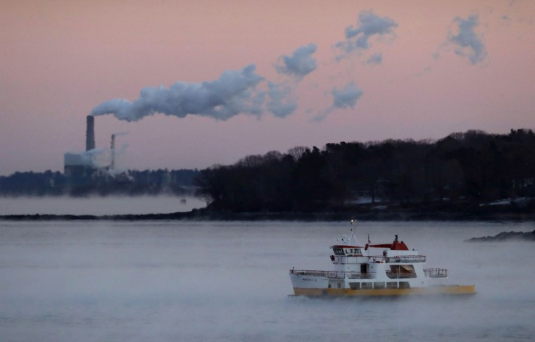 A ferry makes its way through sea smoke as it brings commuters from the islands of Casco Bay to Portland, Maine, Friday, Dec. 16, 2016. A stiff wind blows smoke from power plant on Cousins Island in background. The temperature in Portland dropped to minus-2 degrees F with a wind chill of minus-25. (AP Photo/Robert F. Bukaty)