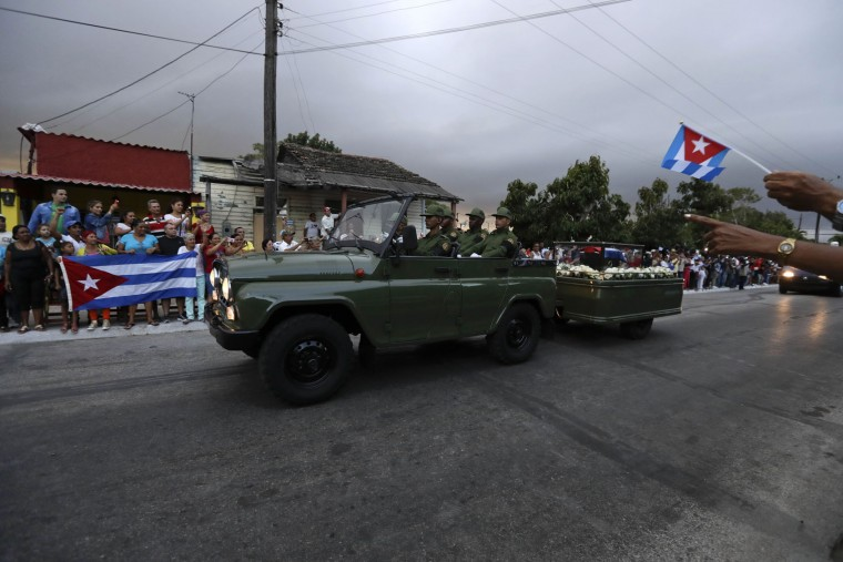 In this Dec. 1, 2016 photo, placed in a small coffin covered by a Cuban flag, the ashes of Cuba's late leader Fidel Castro are driven along the streets of Florida, Cuba. Castro's ashes journeyed across Cuba from Havana to their final resting place in the eastern city of Santiago. (AP Photo/Natacha Pisarenko)