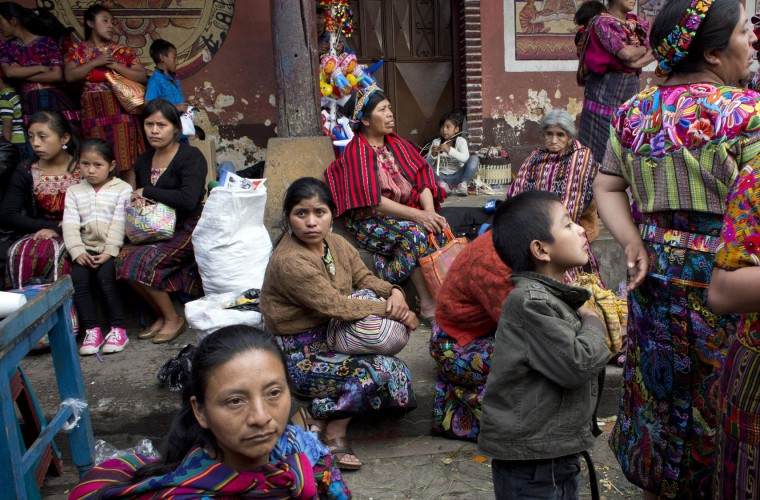 Women and children attend a celebration honoring Saint Thomas, the patron saint of Chichicastenango, Guatemala, Wednesday, Dec. 21, 2016. The Mayan town marks eight uninterrupted days of celebration in honor of the patron saint. (AP Photo/Moises Castillo)