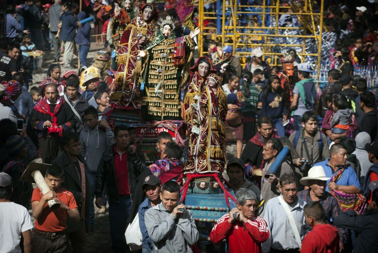 Men carry statues of different religious icons during a procession in honor of Saint Thomas, the patron saint of Chichicastenango, Guatemala, Wednesday, Dec. 21, 2016. Mayan village of Chichicastenango, set in the western Highlands of Guatemala, culminates a week-long festival that began on Dec. 13, honoring the town's patron saint, Santo Tomas. (AP Photo/Moises Castillo)