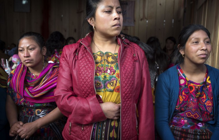 Indigenous women watch fireworks being launched during celebrations honoring Saint Thomas, the saint patron of Chichicastenango, Guatemala, Wednesday, Dec. 21, 2016. The Mayan town marks eight uninterrupted days of celebration in honor of the patron saint. (AP Photo/Moises Castillo)