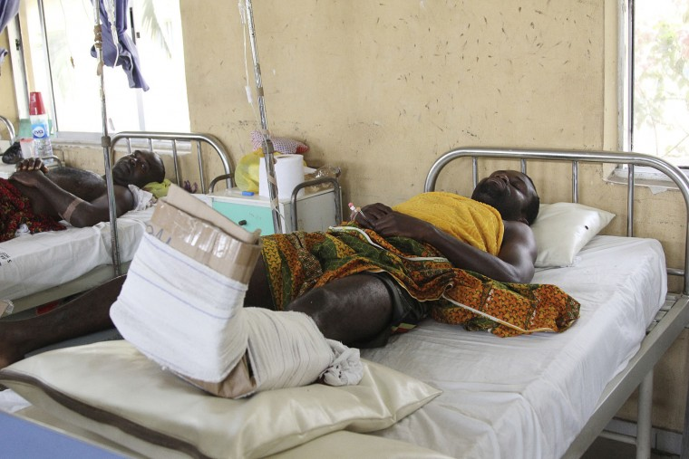 Victims of the collapsed Reigners Bible Church International building receive treatment at the university teaching hospital in Uyo, Nigeria, Monday, Dec. 12, 2016. Metal girders and the roof of a crowded church collapsed onto worshippers in southern Nigeria, killing at least 160 people with the toll likely to rise, a hospital director said Sunday. (AP Photo)