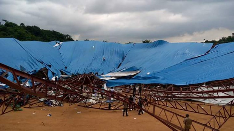 A view of the Reigners Bible Church International that collapsed in the city of Uyo, Nigeria, Sunday, Dec. 11, 2016. The roof collapsed Saturday as some hundreds gathered for the consecration of founder Akan Weeks as its bishop. (AP Photo/Chukwuemeka Nwaneri)
