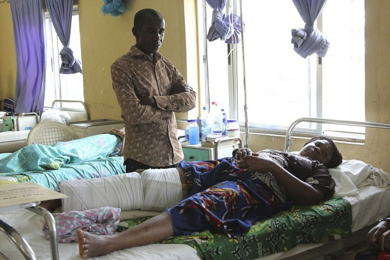 A victim of the collapsed Reigners Bible Church International building receives treatment at the university teaching hospital in Uyo, Nigeria, Monday, Dec. 12, 2016. Metal girders and the roof of a crowded church collapsed onto worshipers in southern Nigeria, killing at least 160 people with the toll likely to rise, a hospital director said Sunday. (AP Photo)