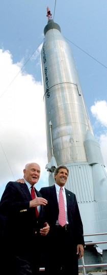 In a Monday, July 26, 2004 file photo, former astronaut and Senator John Glenn, left,with presidential candidate John Kerry, walks past a replica of the Mercury Atlas rocket that took Glenn into space, during Kerry's campaign stop at the Kennedy Space Center Visitor Center, near Cape Canaveral. Former astronaut and U.S. Sen. John Glenn Thursday, Dec. 8, 2016, died in Ohio. He was 95. (Joe Burbank/Orlando Sentinel via AP, File)
