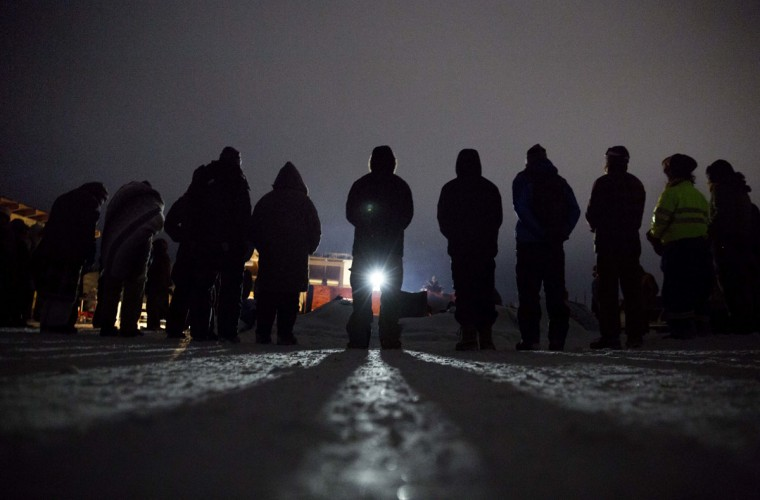 In this Wednesday, Nov. 30, 2016 photo, people form a circle for the morning prayer at the Oceti Sakowin camp where many have gathered to protest the Dakota Access pipeline near Cannon Ball, N.D. President-elect Donald Trump supports completion of the disputed Dakota Access oil pipeline in the Midwest, a view based on policy and not the billionaire businessman's investments in a partnership building the $3.8 billion pipeline. (AP Photo/David Goldman)
