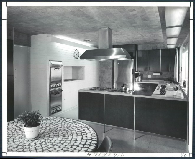 A Carefully planned yellow mustard and brown kitchen has cork walls ceiling. There is a full wall of storage cabinets in dinette area where dining table foreground is topped with Italian ceramic tile. Photo dated December 8, 1963. (Aubrey A. Bodine/Baltimore Sun)