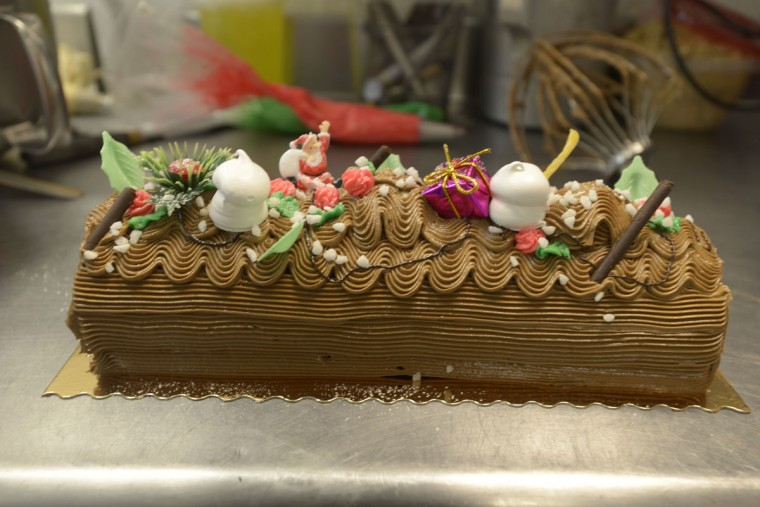 Chef Gerard Billebault of Bonjour prepares Buche de Noel cake the same way his own father did in Paris, decades ago. (Christina Tkacik/Baltimore Sun)
