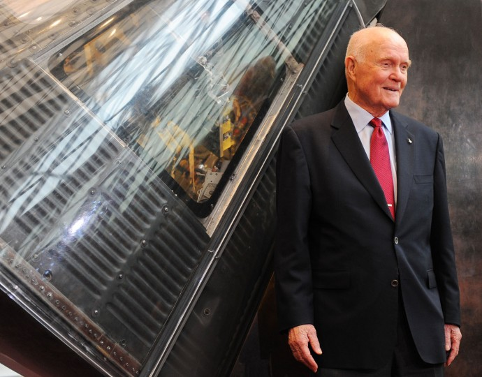 John Glenn poses for photos beside the Mercury Friendship 7 capsule at the National Air and Space Museum in Washington, D.C., on June 23, 2001. (Washington Post photo by Ricky Carioti)
