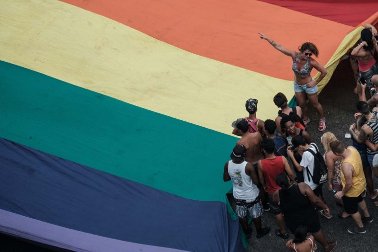 Revellers take part in the 21st Rio LGBT pride parade at Copacabana beach in Rio de Janeiro, Brazil, on December 11, 2016. (YASUYOSHI CHIBA/AFP/Getty Images)