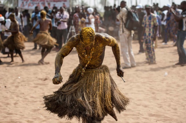 A Voodoo devotee in a trance performs at the annual Voodoo Festival on January 10, 2017 in Ouidah. (STEFAN HEUNIS/AFP/Getty Images)