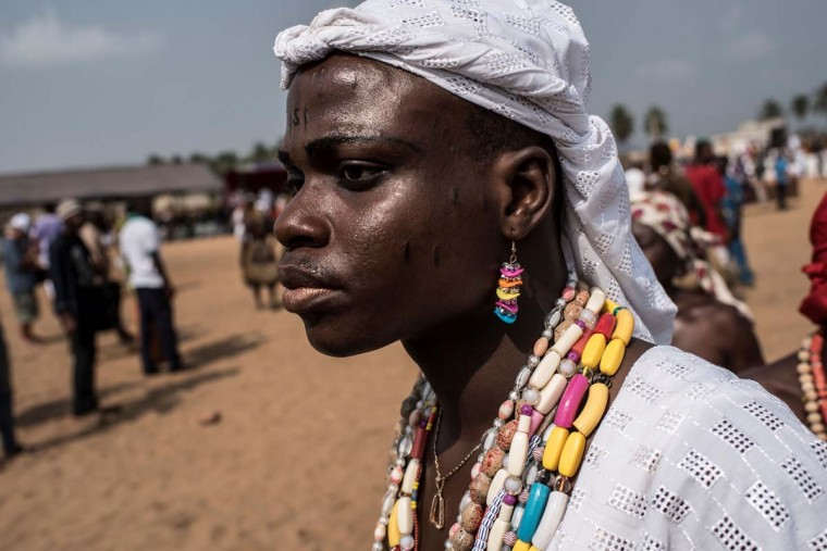 A Voodoo devotee arrives at the festival ground of the annual Voodoo Festival on January 10, 2017 in Ouidah. (STEFAN HEUNIS/AFP/Getty Images)
