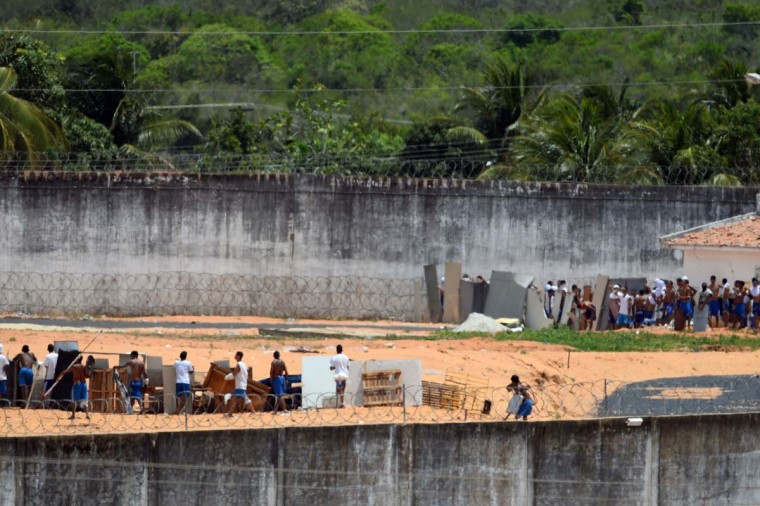 Rival prisoners prepare for confrontation using makeshift shields and weapons at the Alcacuz Penitentiary Center near Natal in Rio Grande do Norte, Brazil on January 17, 2017. A deadly tumult exploded on Saturday at Natal's overcrowded jail, on Sunday, police had invaded the prison and ended a night riot. They found 26 prisoners killed, most of them beheaded. It was the third major massacre to hit Brazil's overcrowded jails this month, all of them thought to involve suspected drug gangs. (ANDRESSA ANHOLETE/AFP/Getty Images)