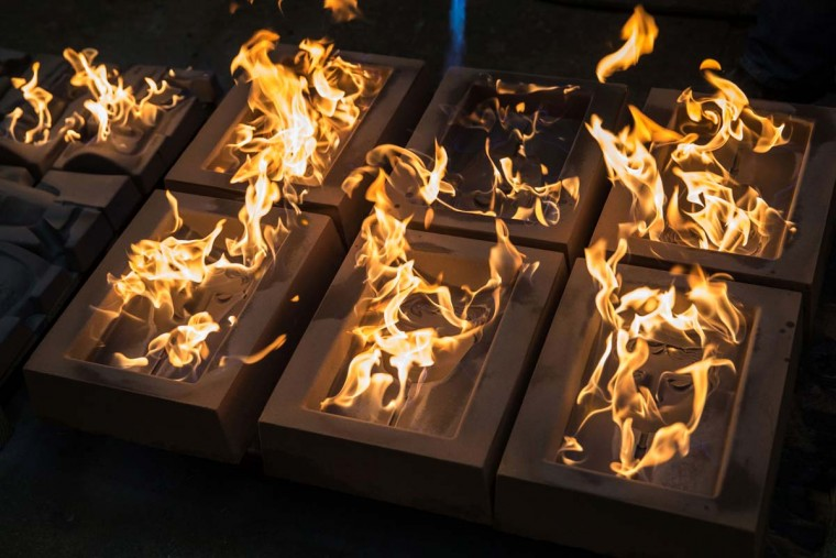 BAFTA (British Academy of Film and Television Arts) mask moulds are set alight to burn off any impurities before casting, during a photocall at the New Pro Foundries, west of London on January 31, 2017. The masks will be presented to winners at BAFTA's awards ceremony in London on February 12, 2017. (DANIEL LEAL-OLIVAS/AFP/Getty Images)