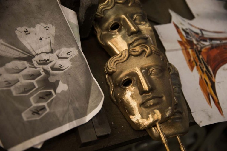 BAFTA (British Academy of Film and Television Arts) masks are pictured after being cast during a photocall at the New Pro Foundries, west of London on January 31, 2017. The masks will be presented to winners at BAFTA's awards ceremony in London on February 12, 2017. (DANIEL LEAL-OLIVAS/AFP/Getty Images)