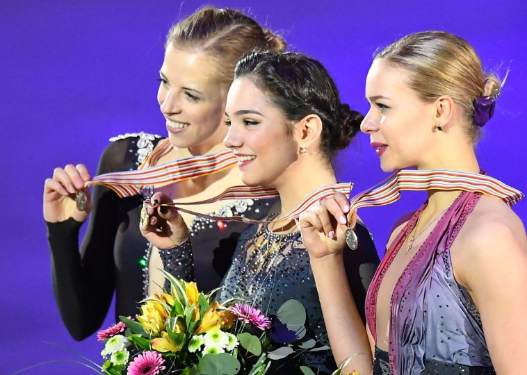 (L to R) Third placed Italy's Carolina Kostner, winner Russia's Evgenia Medvedeva and second placed Russia's Anna Pogorilaya pose with their medals of the ladies free skating competition of the European Figure Skating Championship in Ostrava, Czech Republic on January 27, 2017. (Joe Klamar/AFP/Getty Images)