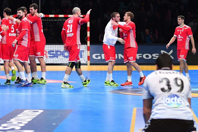 Egypt's left back Yehia Elderaa (right) looks at Croatia's players celebrating after winning the 25th IHF Men's World Championship 2017 eighth final handball match Croatia vs Egypt on January 22, 2017 at the Arena in Montpellier. (PASCAL GUYOT/AFP/Getty Images)