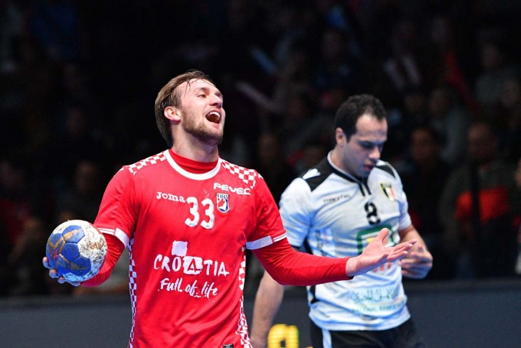 Croatia's center back Luka Cindric (left) reacts during the 25th IHF Men's World Championship 2017 eighth final handball match Croatia vs Egypt on January 22, 2017 at the Arena in Montpellier. (PASCAL GUYOT/AFP/Getty Images)