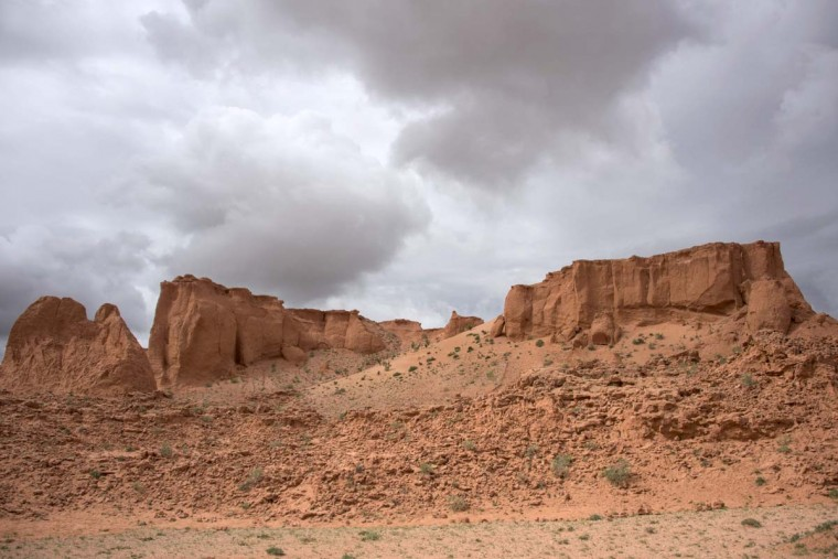 This picture taken on June 27, 2016 shows the Flaming Cliffs in the Gobi desert. For years, herder Gelegrash had a sideline bringing tourists to see a dinosaur skull hidden near the Flaming Cliffs in Mongolia's Gobi desert. Then, one day, it was gone. It is one of thousands of ancient fossils that have disappeared from the country since American explorer Roy Chapman Andrews -- supposedly the inspiration for the movie character Indiana Jones -- discovered dinosaur eggs there nearly a century ago. (JOHANNES EISELE/AFP/Getty Images)