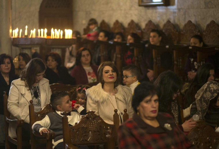 Palestinian Orthodox Christians attend a Christmas mass at the Saint Porphyrios Greek Orthodox church in Gaza City on January 7, 2017. According to the Gregorian calendar, Orthodox Christmas falls 13 days after the December 25 Western feast celebrated in line with the Julian calendar. (AFP PHOTO / MAHMUD HAMS)