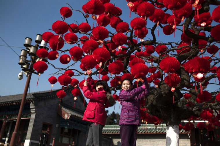 Chinese children pose for a photograph beside a lantern tree display ahead of the Lunar New Year in Beijing on January 24, 2017. The Lunar New Year, known locally as the Spring Festival, falls on January 28 this year and marks the Year of the Rooster in the Chinese calendar. (Fred Dufour/AFP/Getty Images)