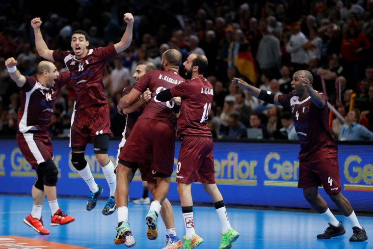 Qatar's pivot Bassel Alrayes (left), Qatar's left wing Murad Abdulrazzaq (second left), Qatar's left wing Hassan Mabrouk (right) and teammates celebrate after Qatar defeated Germany in the 25th IHF Men's World Championship 2017 eighth final handball match Germany vs Qatar on January 22, 2017 at the AccorHotels Arena in Paris. (THOMAS SAMSON/AFP/Getty Images)