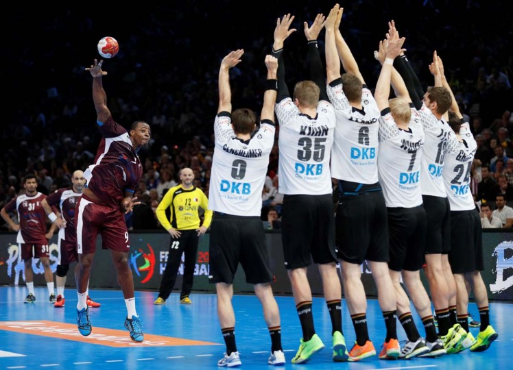 Qatar's left back Rafael Capote (left) shoots a free kick over Germany's players during the 25th IHF Men's World Championship 2017 eighth final handball match Germany vs Qatar on January 22, 2017 at the AccorHotels Arena in Paris. (THOMAS SAMSON/AFP/Getty Images)