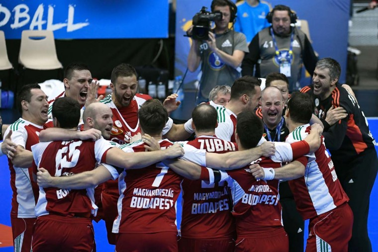Hungary's right back Zsolt Balogh (third from left) and his teammates celebrate winning the 25th IHF Men's World Championship 2017 eighth final handball match Hungary vs Denmark on January 22, 2017 at the Halle Olympique in Albertville. (PHILIPPE DESMAZES/AFP/Getty Images)