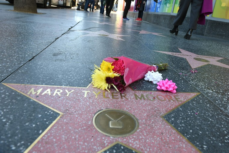 Flowers are placed on the actress Mary Tyler Moore's Hollywood Walk of Fame star on January 25, 2017 in Hollywood, California. Legendary actress Mary Tyler Moore, who delighted a generation of Americans with her energetic comic performances and broke barriers with her iconic portrayal of a single career woman, died on January 25, 2017 after years of ill health. She was 80. (Robyn Beck/AFP/Getty Images)