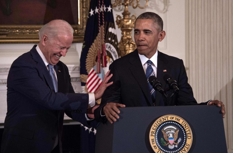 U.S. Vice President Joe Biden laughs as President Barack Obama speaks during a tribute to Biden at the White House in Washington, DC, on January 12, 2017. (Nicholas Kamm/AFP/Getty Images)