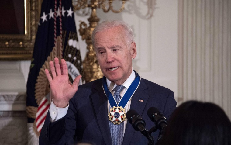 U.S. Vice President Joe Biden acknowledges applause after President Barack Obama awarded him the Presidential Medal of Freedom during a tribute to Biden at the White House in Washington, DC, on January 12, 2017. (Nicholas Kamm/AFP/Getty Images)
