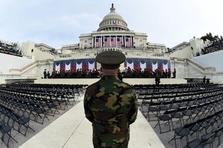 The United States Marine Corps Band practices in front of the podium where US President-elect Donald Trump will take the oath of office and be sworn in as the 45th US president in Washington, DC on January 19, 2017. Twenty-four hours before he takes the oath of office as the 45th US president, Trump arrived in Washington on Thursday, determined to transform American politics over the next four years. (AFP PHOTO / TIMOTHY A. CLARY)