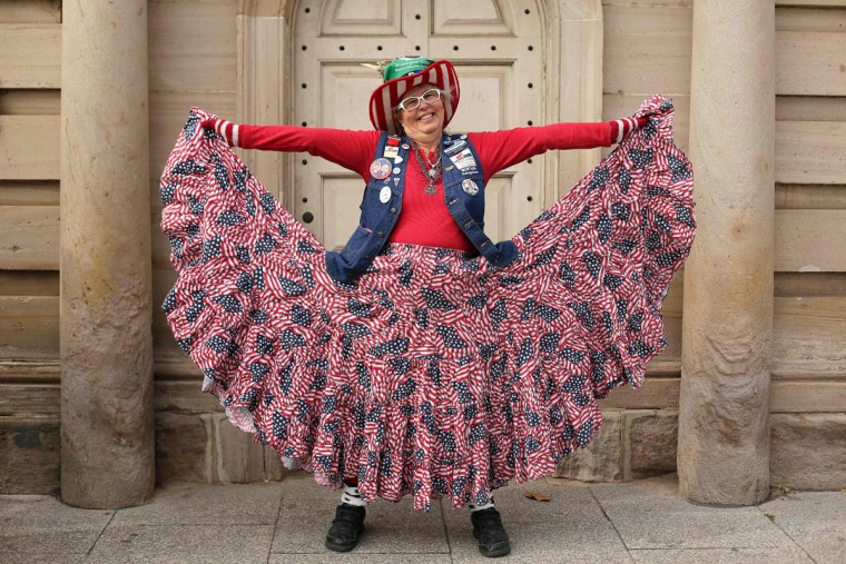 Susan Reneau poses for a portrait as she shows off her patriotic outfit near Constitution Avenue on January 19, 2017, in Washington, DC. US Presidential-elect Donald Trump will be sworn in on january 20 as the 45th President of the United States. (AFP PHOTO / Joshua LOTT)