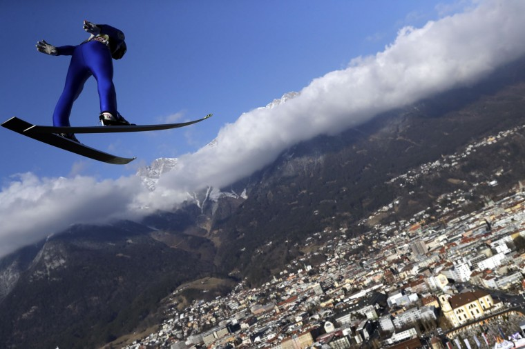 Michael Hayboeck of Austria soars through the air during his trial jump at the third stage of the 65th four hills ski jumping tournament in Innsbruck, Austria, Tuesday, Jan. 3, 2017. (AP Photo/Matthias Schrader)