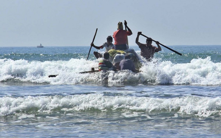 In this Jan. 16, 2017, photo, Rohingya fishermen launch a raft made of empty plastic containers to go fishing into the rough sea off of Tha Pyay Taw village, Maungdaw, western Rakhine state, Myanmar. Their usual, sturdy fishing boats were outlawed three months ago when Myanmar authorities launched a sweeping and violent counter-insurgency campaign in Rakhine state, home to the long-persecuted Rohingya Muslim minority. The ban on fishing boats -- meant to prevent insurgents from entering or leaving the country by sea -- is just one small provision in the wider crackdown, in which authorities have been accused of widespread abuses. (AP Photo/Esther Htusan)