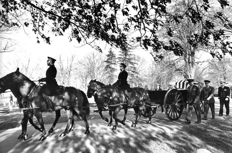FILE - In this Jan. 31, 1967 file photo, a horse-drawn caisson carrying the body of astronaut Virgil Grissom travels to the Arlington National Cemetery in Arlington, Va. Walking beside the flag-draped casket as honor pallbearers are astronauts, from left foreground, Marine Col. John Glenn, Air Force Col. Gordon Cooper, Navy Cmdr. John Young; from left background are Donald Slayton, Navy Capt. Alan Sheperd and Navy Cmdr. Scott Carpenter. Grissom was killed in the Apollo 1 fire on launch pad on Jan. 27, 1967. (AP Photo)