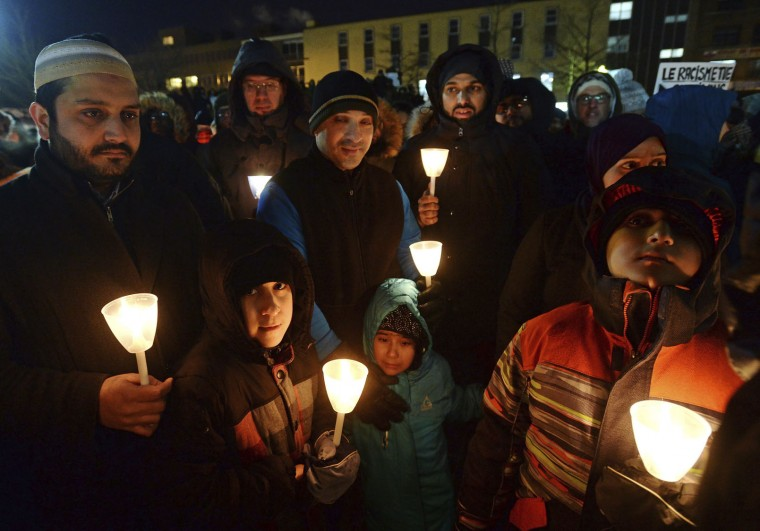 People attend a vigil in Montreal on Monday, Jan. 30, 2017, for victims of Sunday's shooting at a Quebec City mosque. (Ryan Remiorz/The Canadian Press via AP)