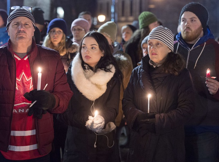 People attend a vigil for victims of Sunday's shooting at a Quebec City mosque, at the Grand Parade in Halifax, Nova Scotia, Monday, Jan. 30, 2017. The 27-year-old suspect in the attack against Muslims at the Quebec City mosque was charged Monday with six counts of first degree murder and five counts of attempted murder. (Andrew Vaughan/The Canadian Press via AP)