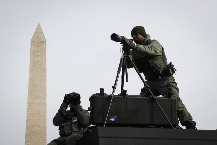 SWAT personnel keep watch beside the Washington Memorial in Washington, Thursday, Jan. 19, 2017, as preparations continue for Friday's presidential inauguration. (AP Photo/John Minchillo)