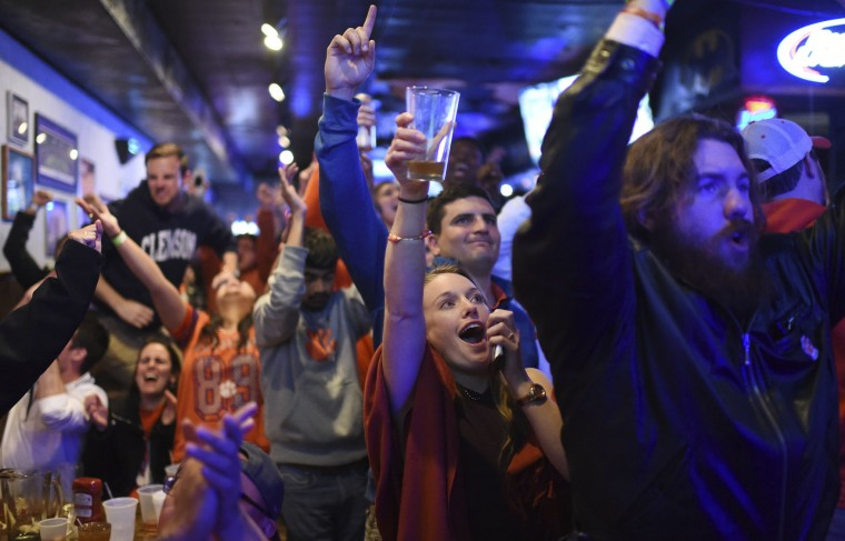 Clemson fans celebrate after a touchdown as they watch the broadcast of the NCAA college football playoff championship game between Clemson and Alabama, Monday, Jan. 9, 2017, in Clemson, S.C. (AP Photo/Rainier Ehrhardt)
